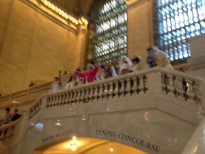 On the balcony overlooking the main floor of Grand Central Terminal, and the crowds looking up at us