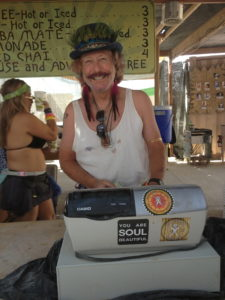 one of the many volunteers who sell coffee at Center Camp. He promoted being an individual while taking my order