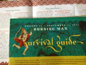 The Burning Man Survival Guide is sent out with your ticket, showcasing the 10 Principals along with info on attending the event.