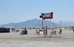 Toilet Bowl art installation by Porto Potties out in the playa