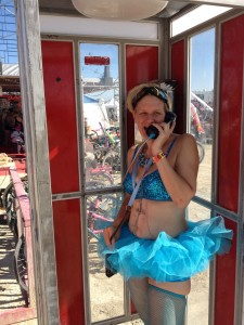 Completely comfortable in a tutu at Burning Man, talking to Grammy