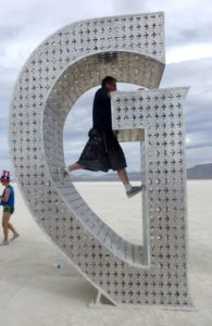 Climbing art at Burning Man (MAGIC)
