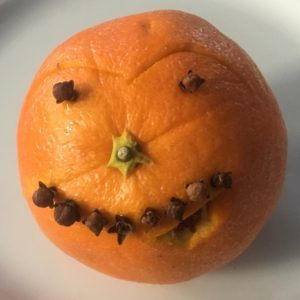 Orange face made with cloves