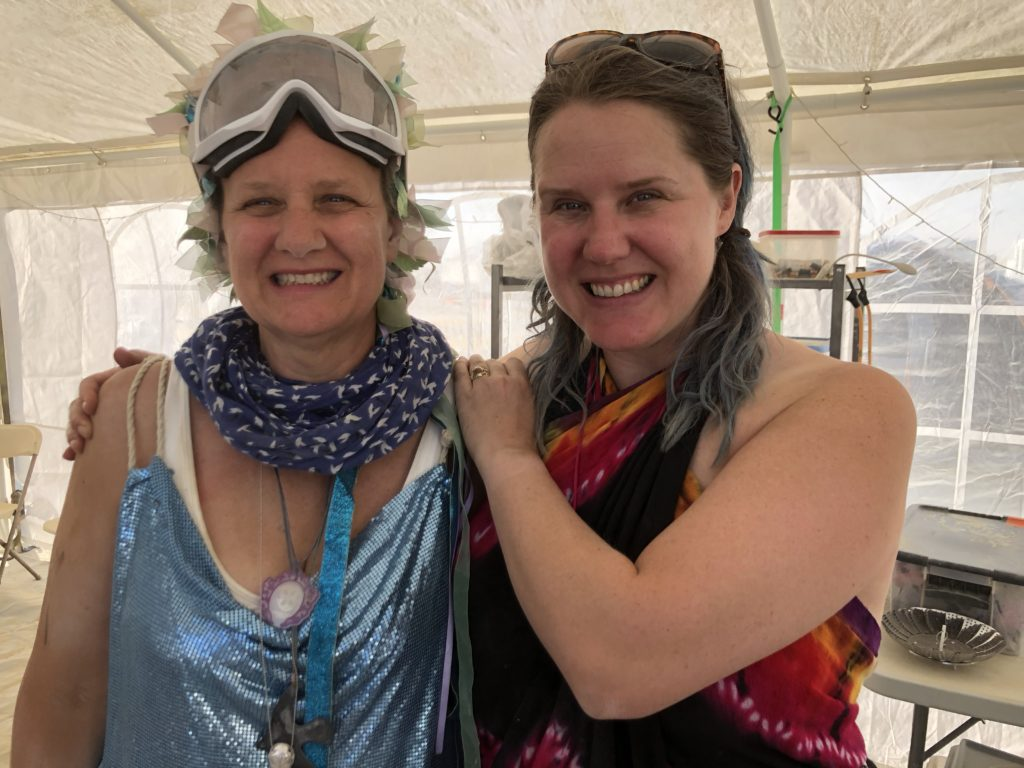 Stacey and Kara have become part of their own tribe, smiling while at Burning Man