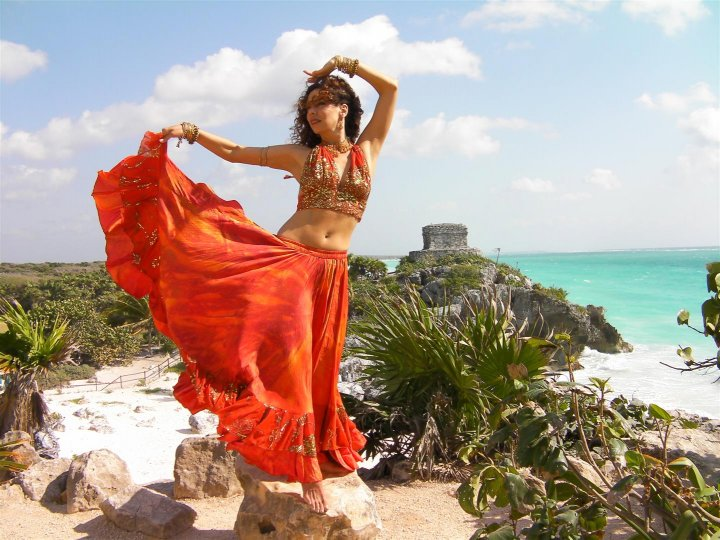 Tara belly dancing on the beach