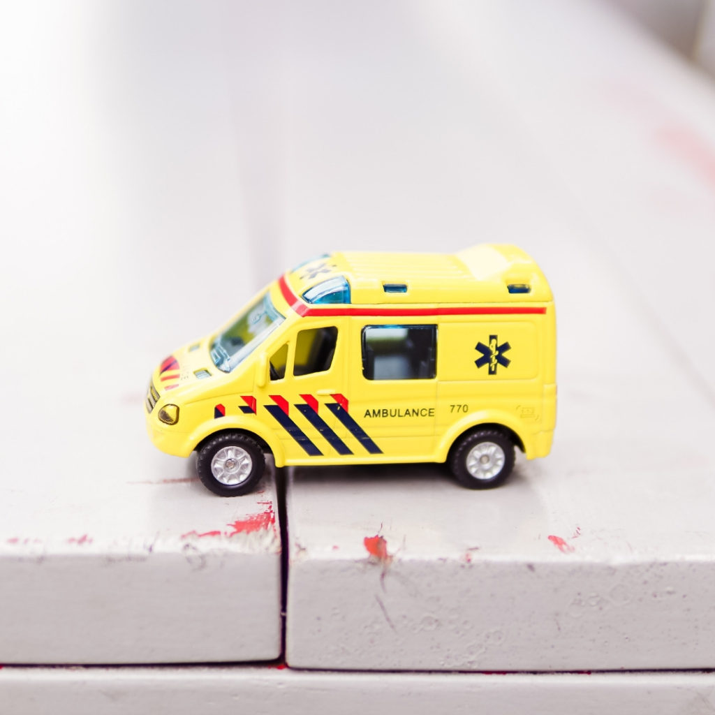 toy ambulance to showcase health insurance for nomads