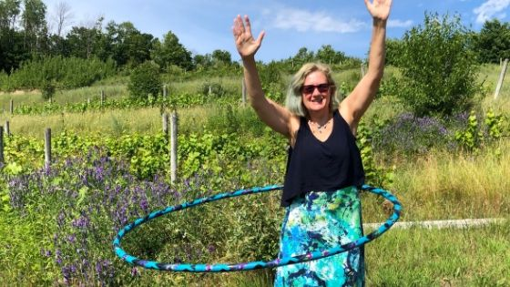 Stacey practicing hula hoop in a winery