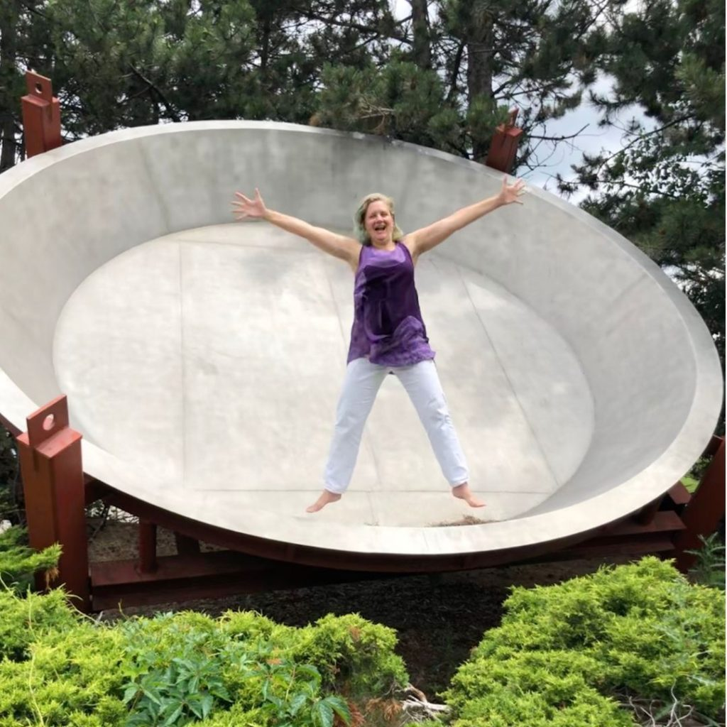 Stacey at play, jumping inside the world's largest pie pan