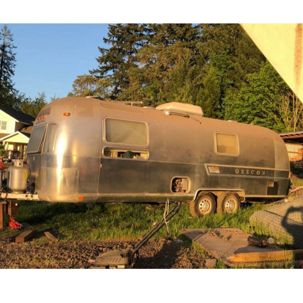 side view of Wednesday our Airstream Adventure in the yard where we bought it