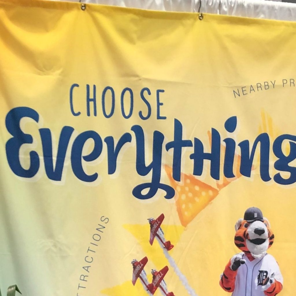 Choose everything sign from a travel expo