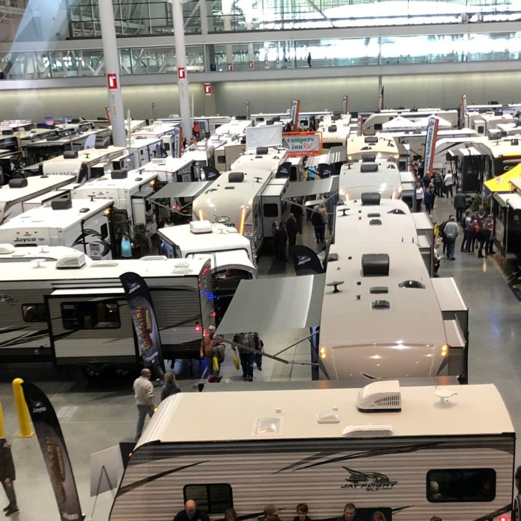 View of many RVs in a large expo hall