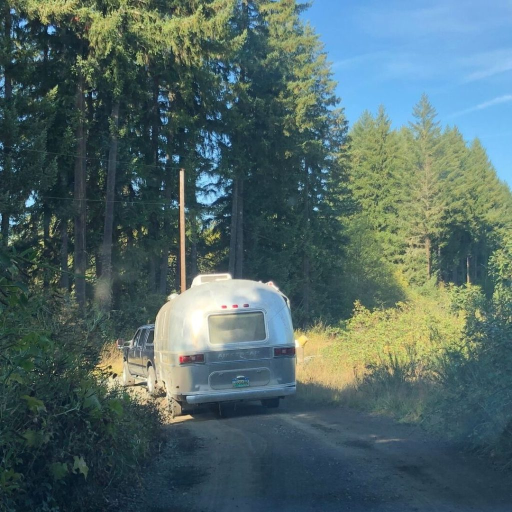 Our Ford truck going down a dirt driveway towing Wednesday our Airstream Adventure