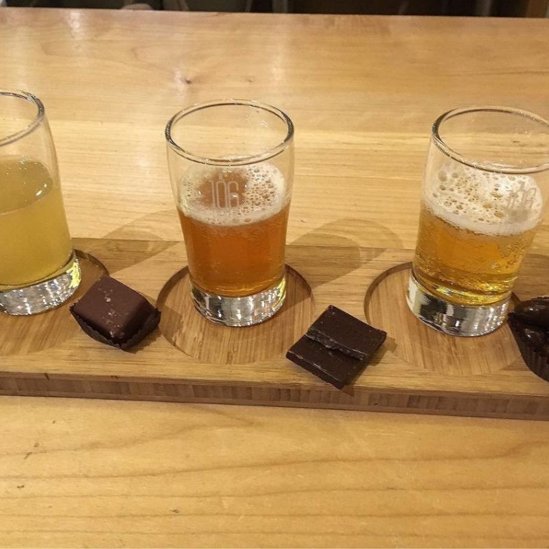 3 tasting glasses with bits of chocolate bars