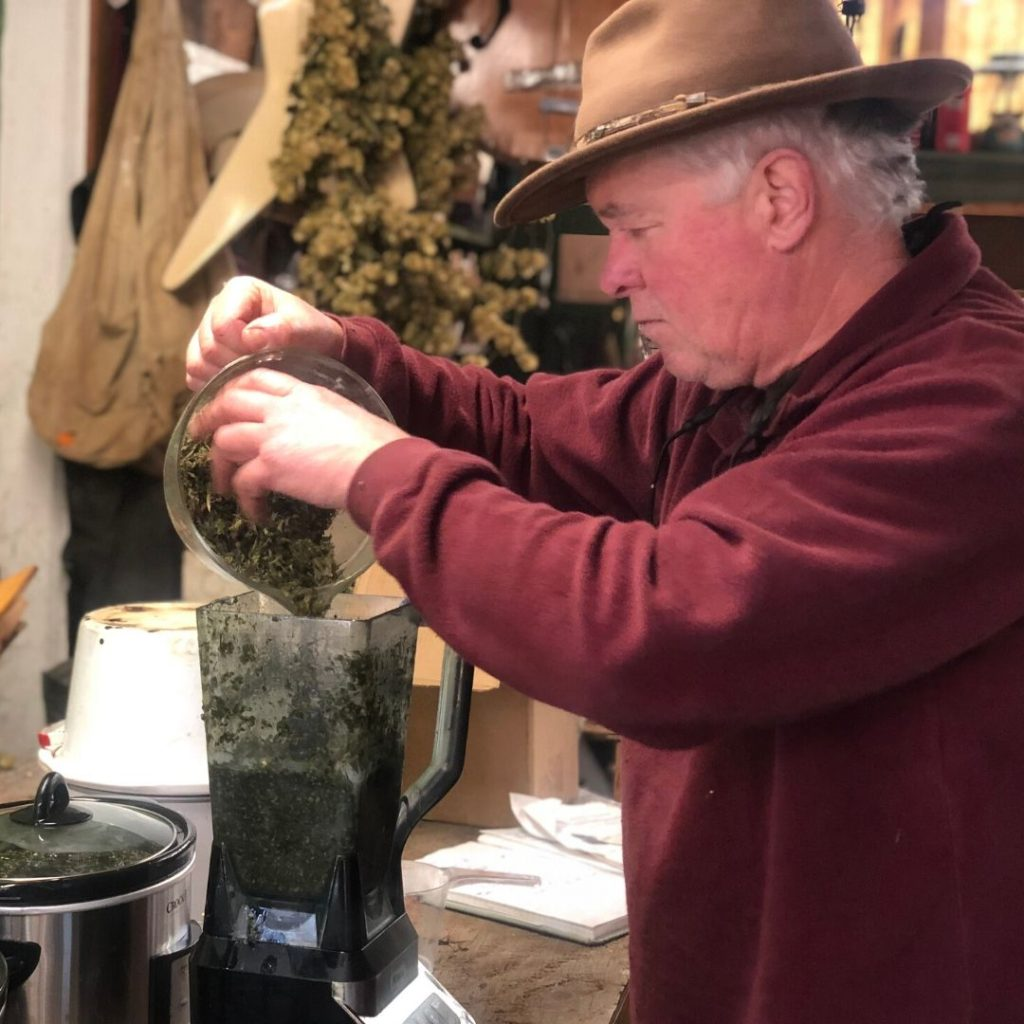 Dave putting ingredients into the Ninja processor to break up the hemp for a better quality CBD cream