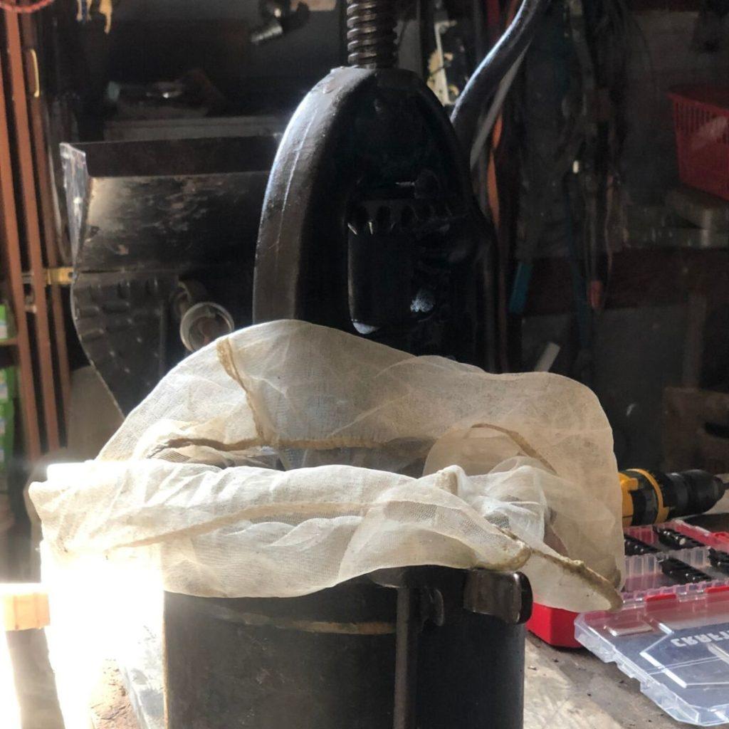 cheese cloth in antique lard press