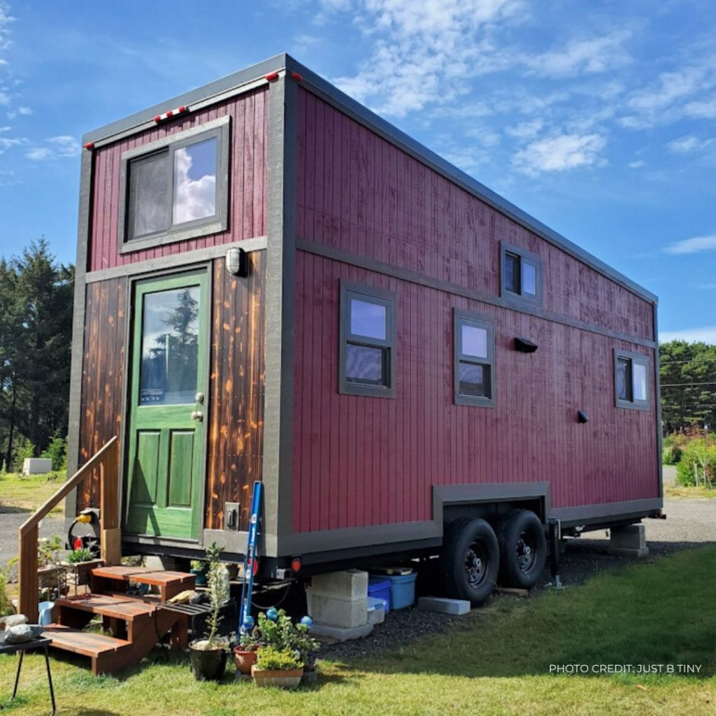 front of tiny house, green door and burgundy sides