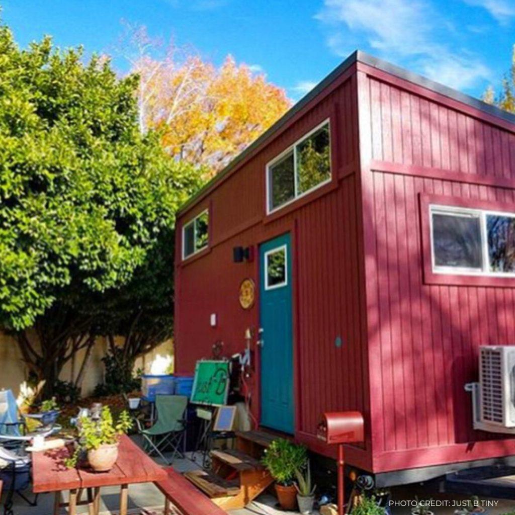 maroon tiny house with blue door