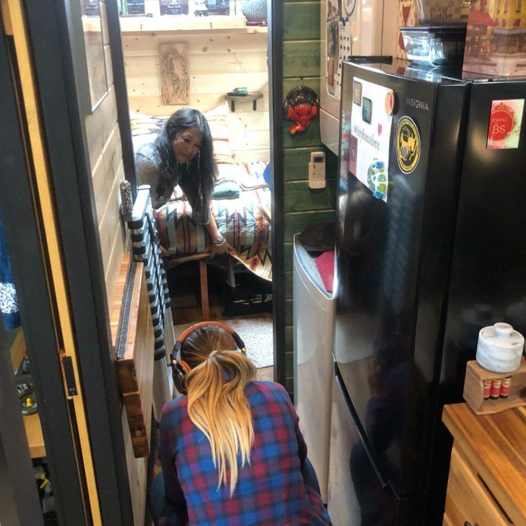 Jenna videoing Brenda inside her tiny house