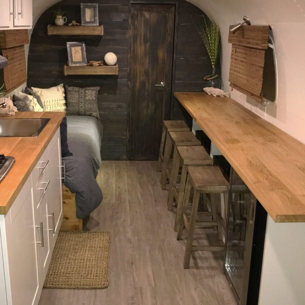 neutral tones and dark wood wall interior of airstream