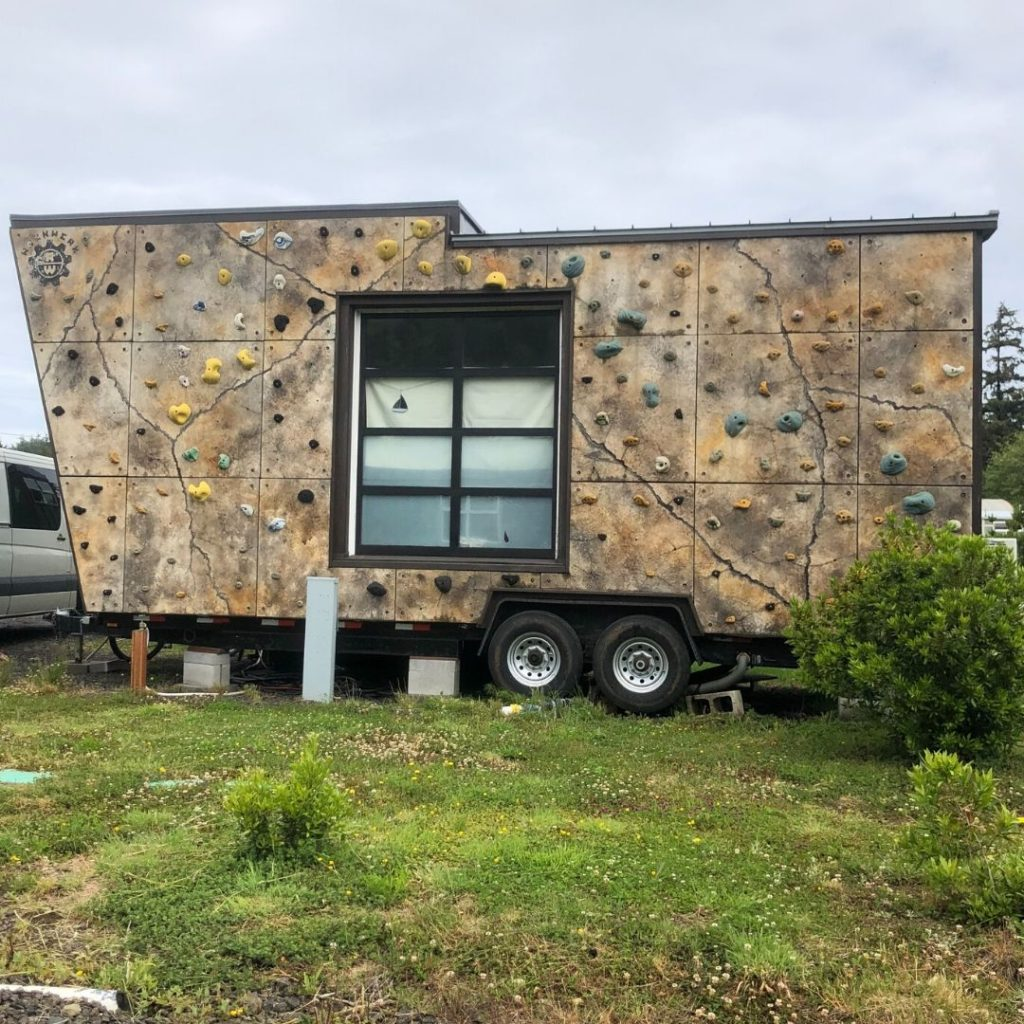 tiny house with rock climbing wall on the side