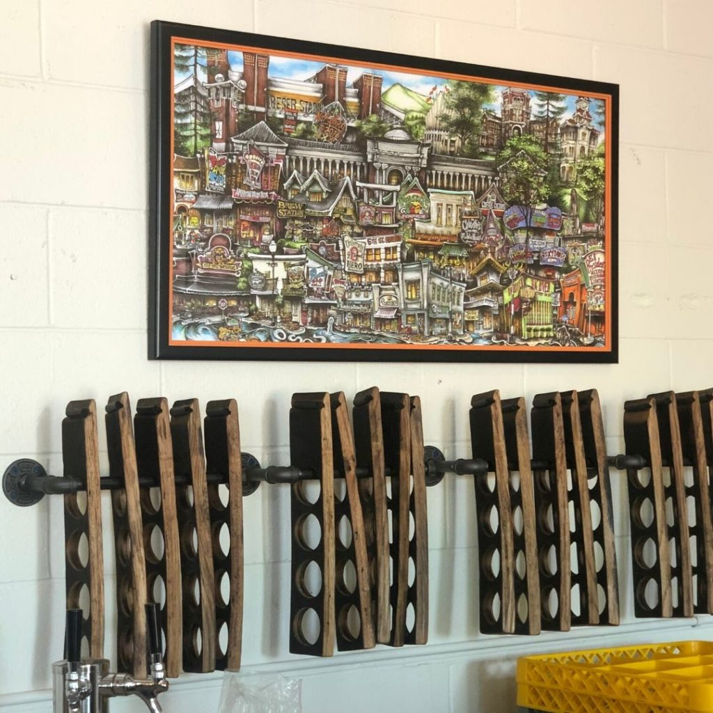 art on wall and handmade beer servers
