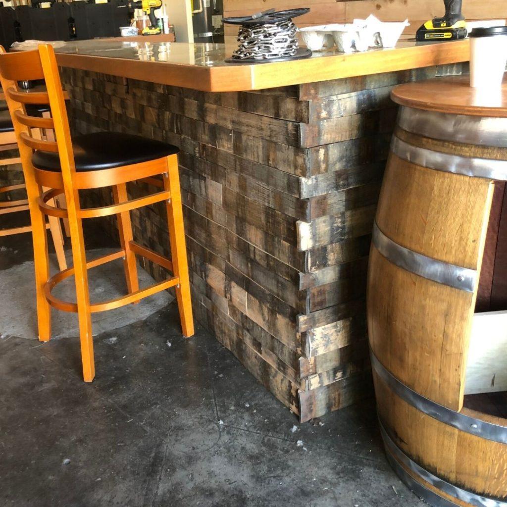 wood accents and keg at bar