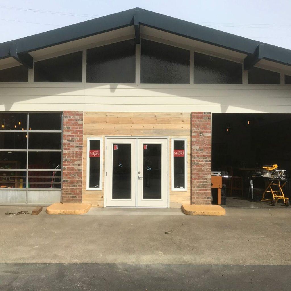 front of restaurant where center garage door has been changed to a regular door