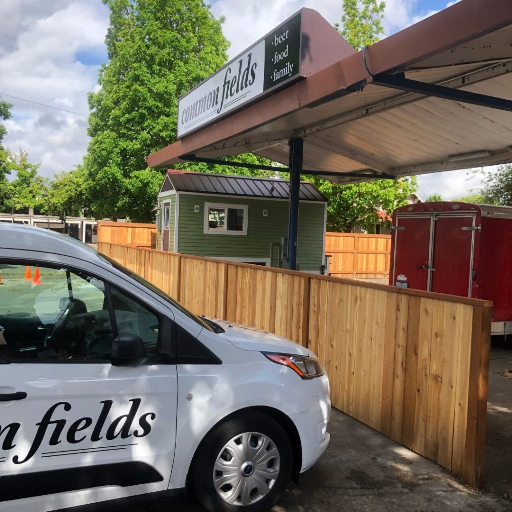 car parked in front of food pod Common Fields