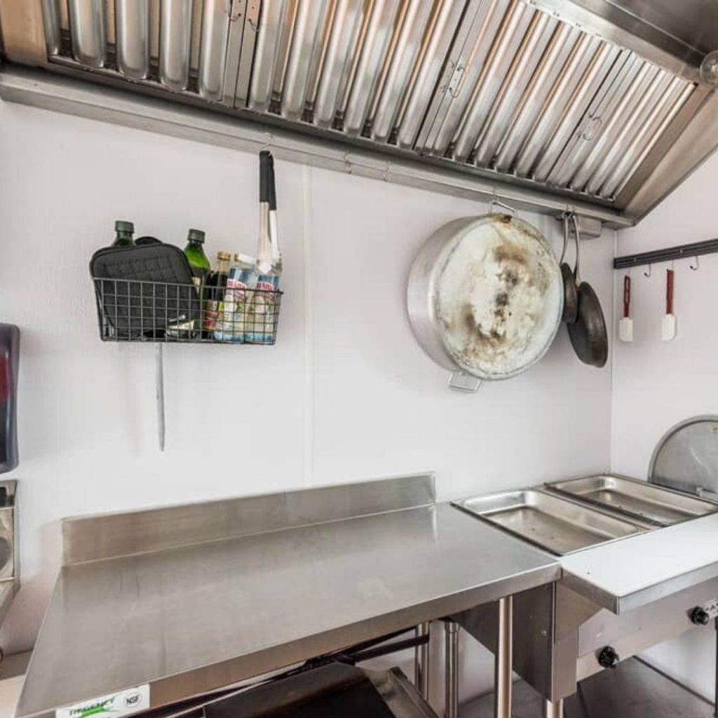 range hood and counters inside food truck tiny house kitchen