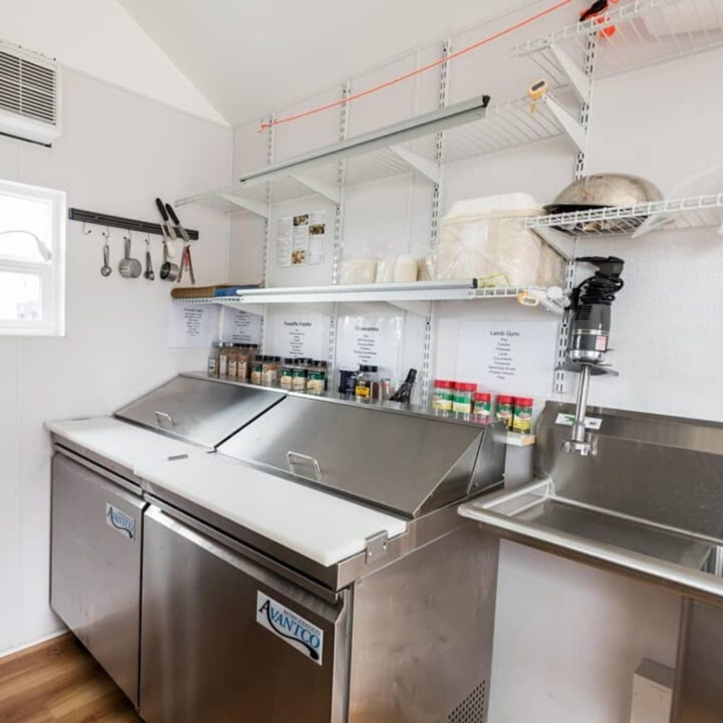 stainless steel equipment in tiny house food truck kitchen