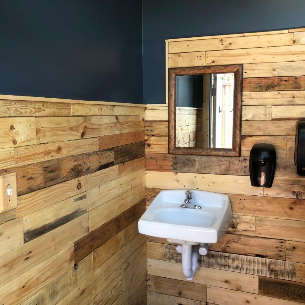 wood walls and bathroom sink