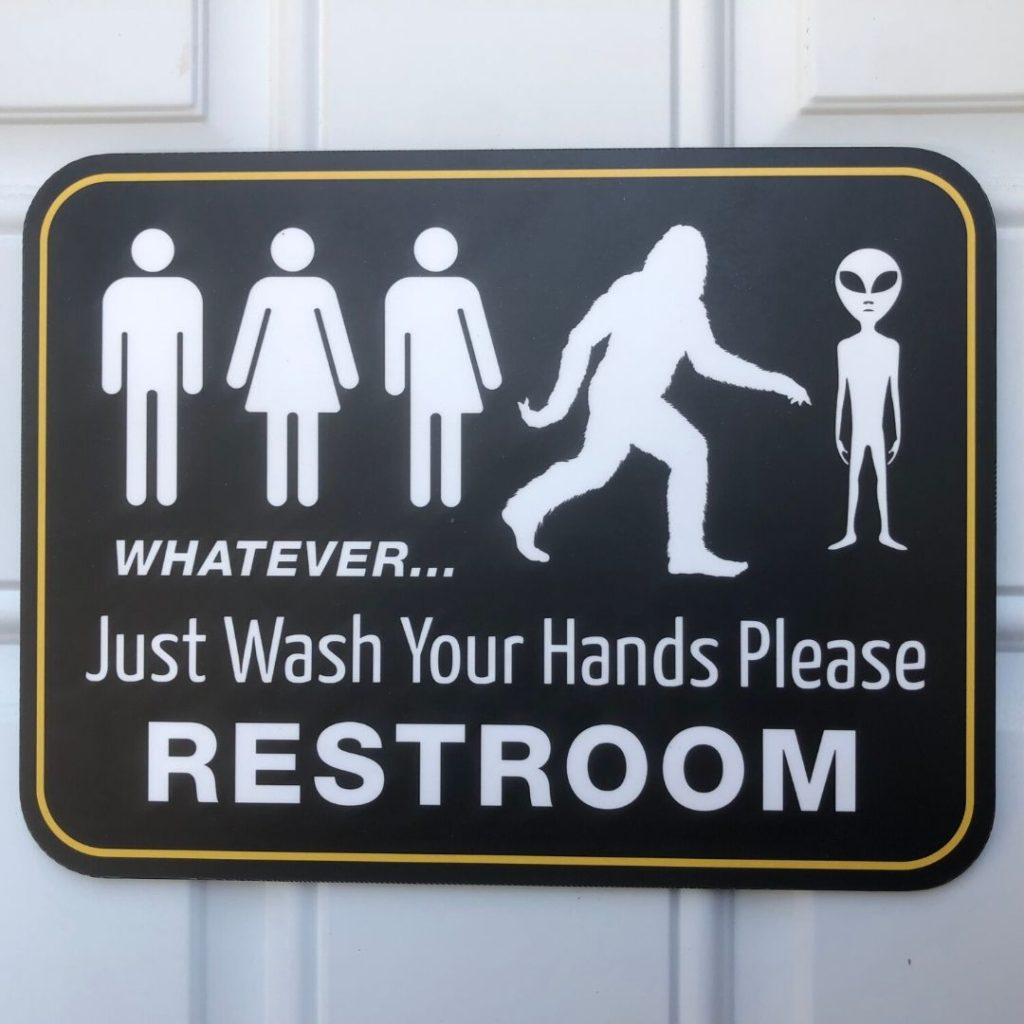 fun restroom sign with people, Big Foot and an alien