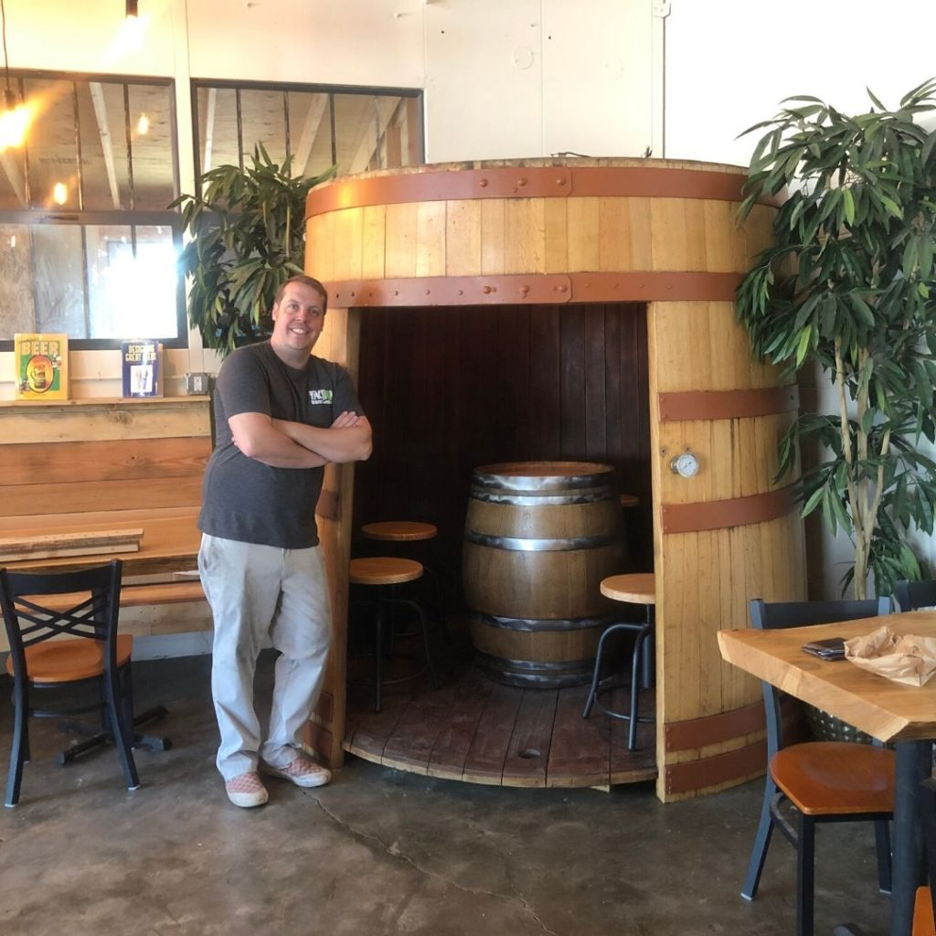 Jacob standing in front of a cask turned into a small room