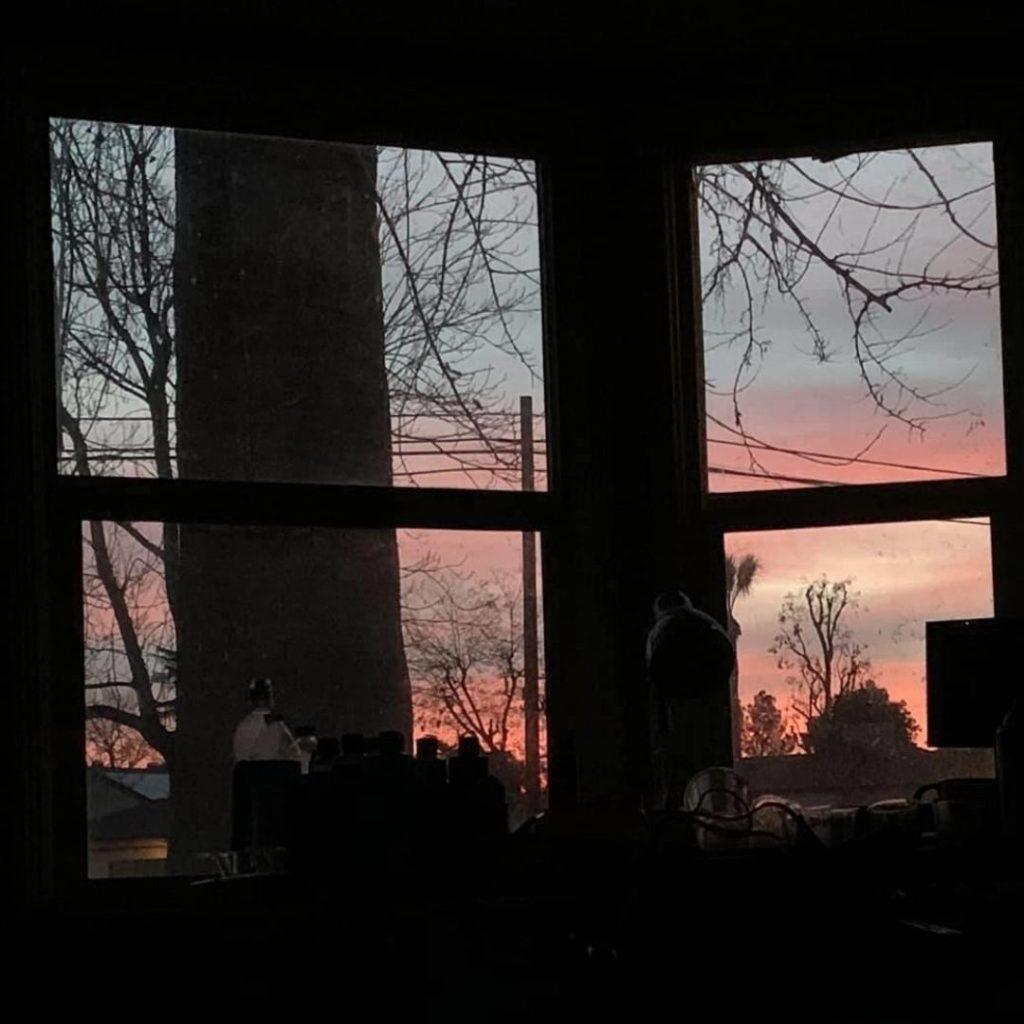 sunset through windows inspiring her first of many haikus