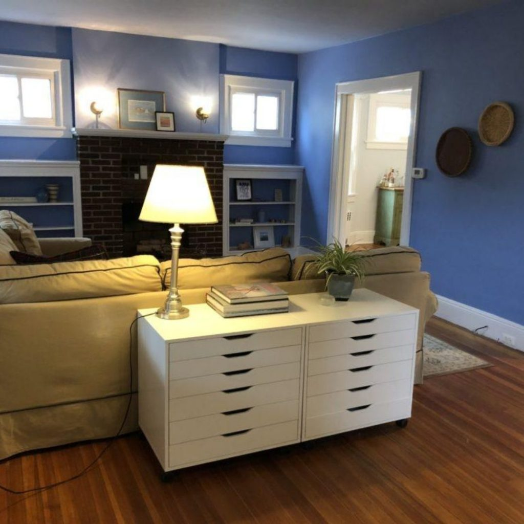 After zen cleaning a staged living room with wood floors and blue walls