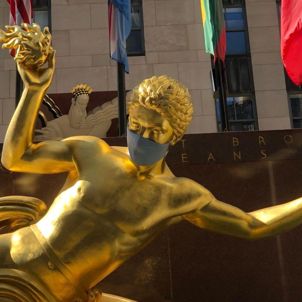 Rockefeller Center gold statue Prometheus wearing a mask
