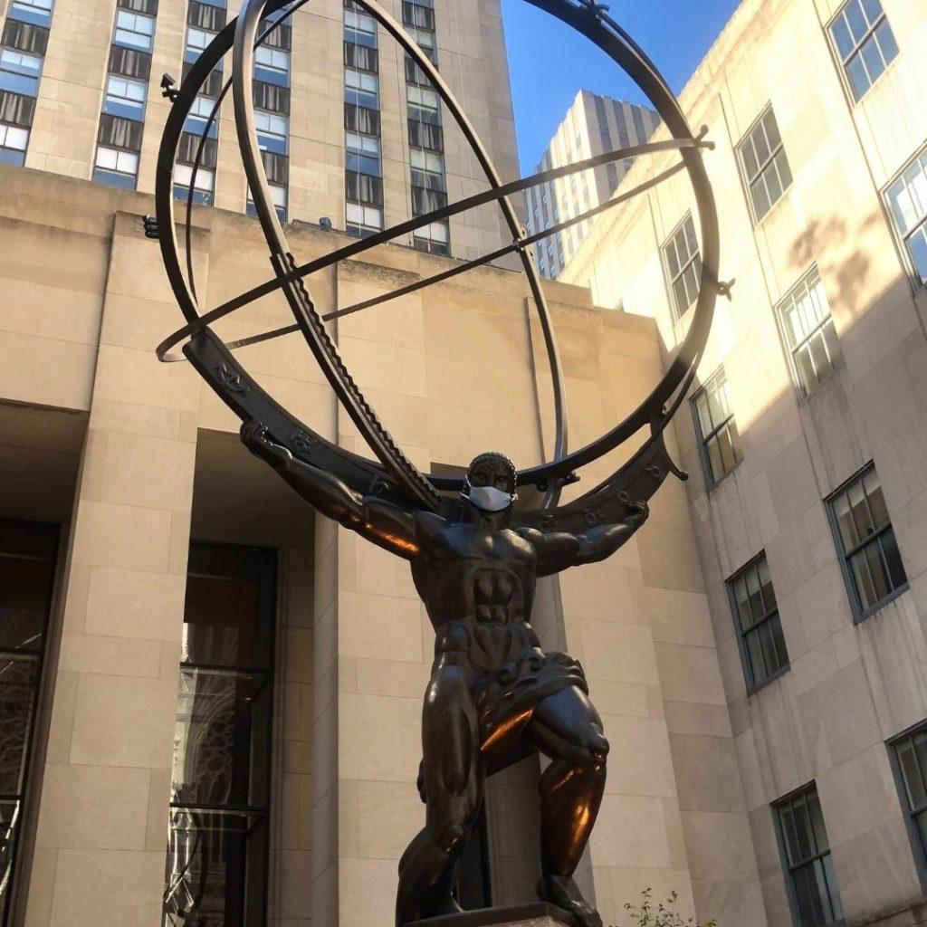 NYC Atlas statue wearing a mask