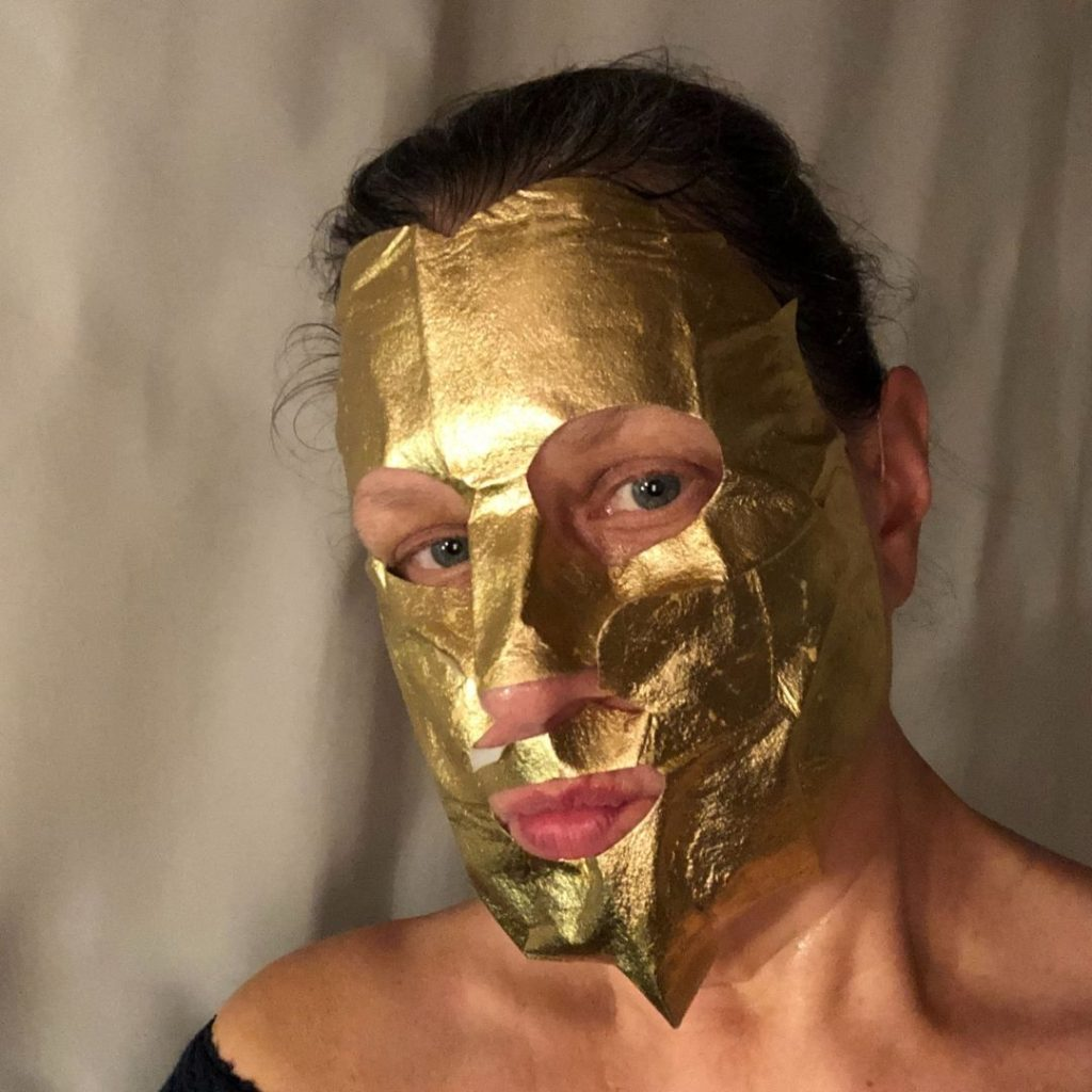 Stacey in a gold beauty mask