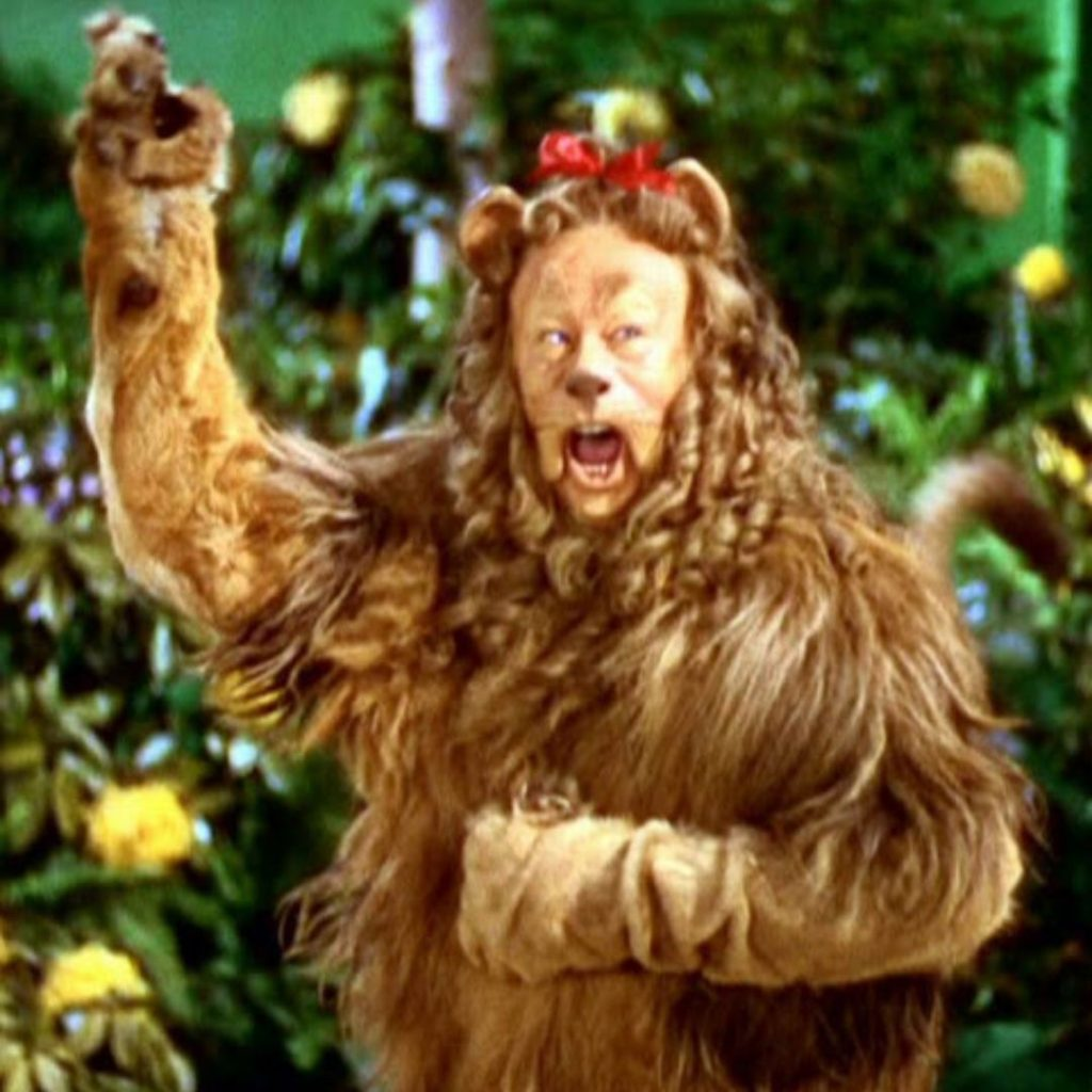 The Cowardly Lion from Wizard of Oz exclaiming about how courage helps in challenging times
