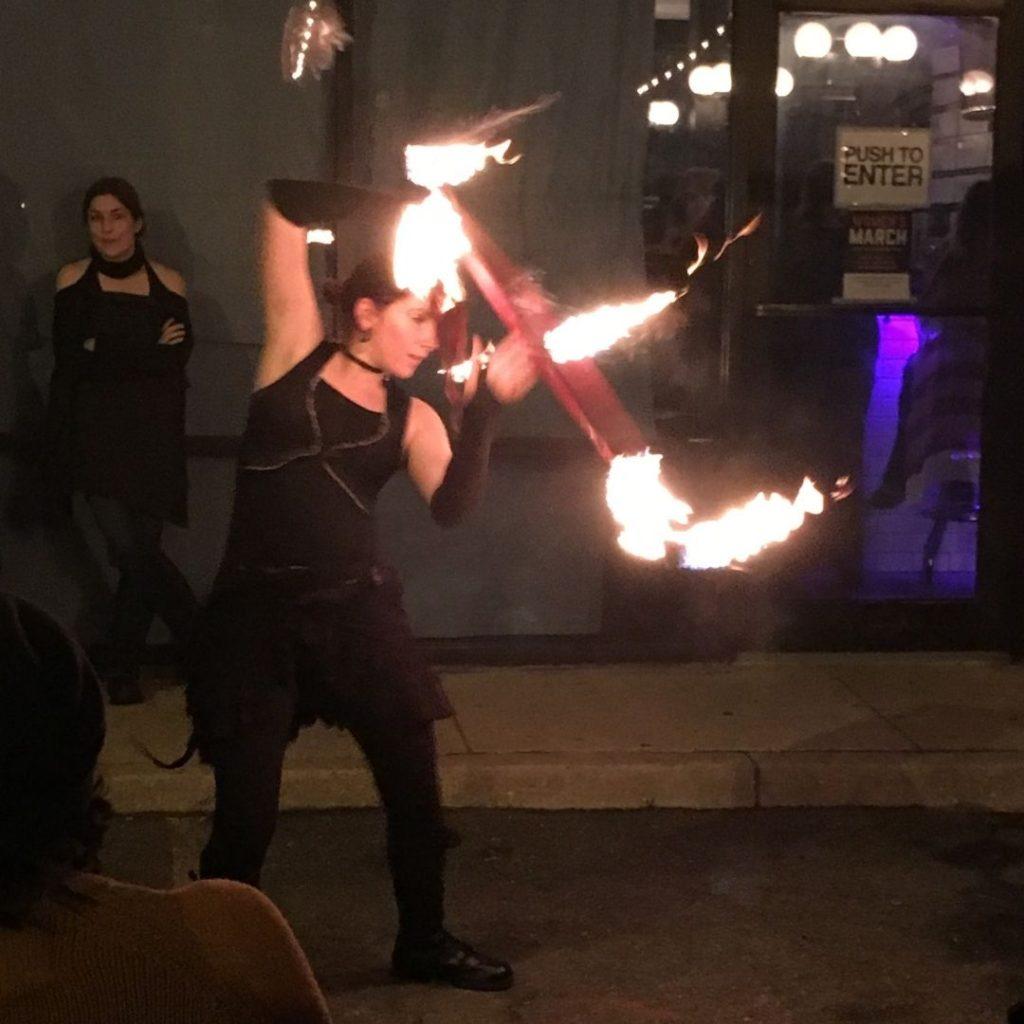 Fire dancer in flow with a hoop of fire