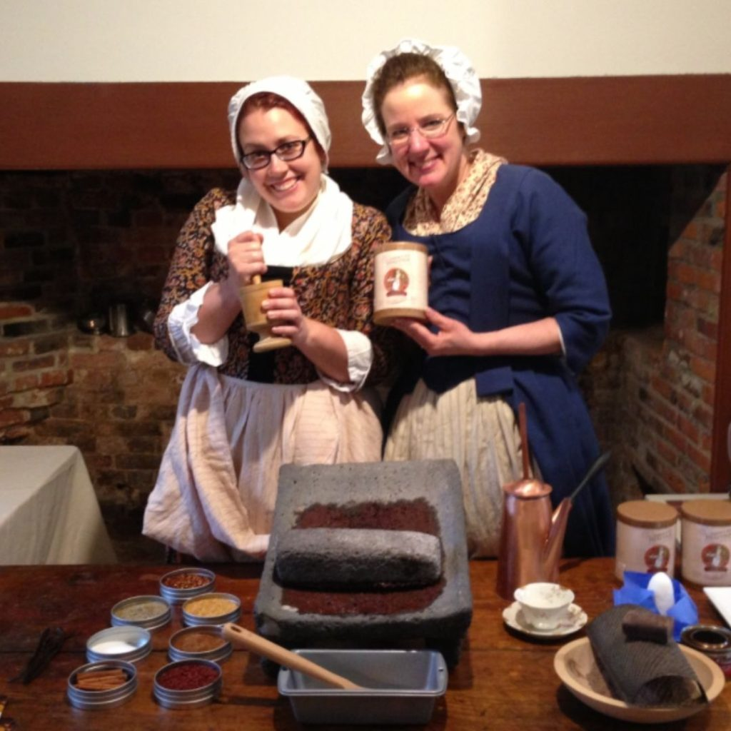New England Colonists at museum showing history in action