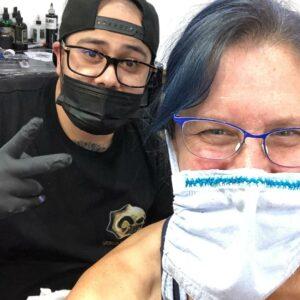 Jose getting ready to work on my tattoo